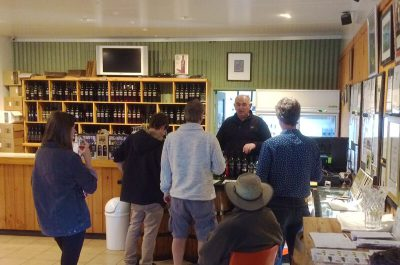 Griffith Tours New South Wales - photo of a tour group tasting wine at a Griffith winery cellar door.